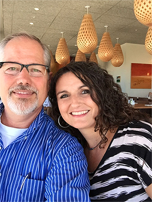 My sexy man and me. (This picture was taken in a restaurant overlooking the beach in Santa Cruz.)